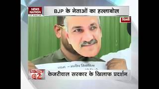 Delhi BJP leaders stage mask-protest against Kejriwal government