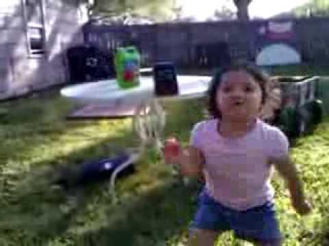 Leah Rebecca dancing in the backyard