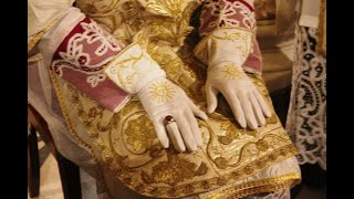 The vesting of the Bishop for the Pontifical Mass