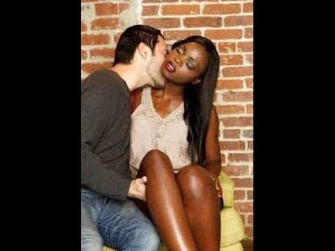 Black woman and white man having sex