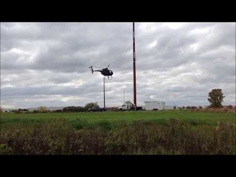Helicopter stringing transmission line pull ropes near Pleasant Prairie, Wis.