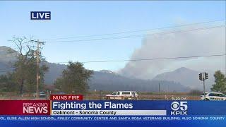 FIREFIGHTERS BATTLE NUN-PARTRICK FIRE:  Hundreds of firefighters battle the expanding Nuns-Partrick