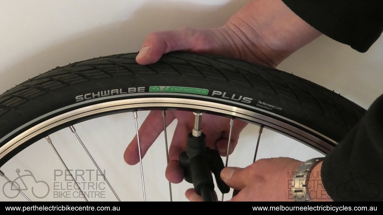 How To Pump Up A Bike Tyre With A Dunlop Valve Youtube
