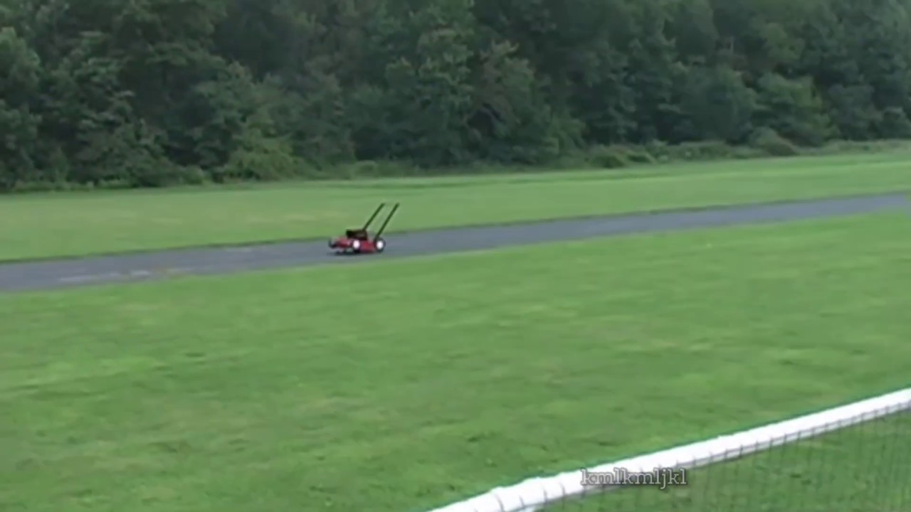 guy shows off his remote control lawnmower