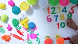 Ishfi and Fahsin make numbers with Play doh