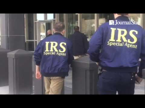 Fed agents outside of Caterpillar World HQ. IRS agents and others wearing bulletproof vests. @pjstar