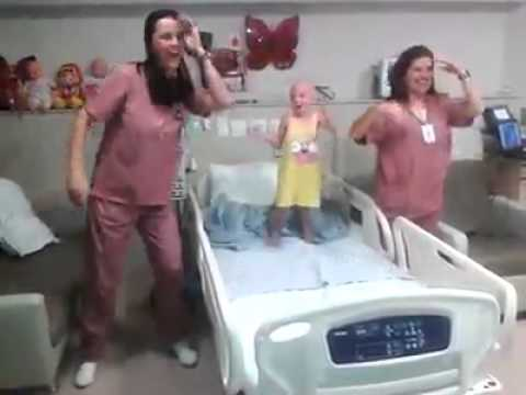 Little Girl With Cancer In Hospital Jumping On Bed