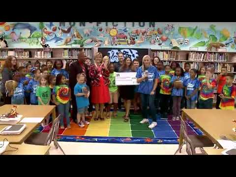 Duke Energy Florida presents a check to Shore Elementary Magnet School of the Arts