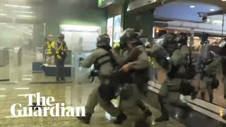 Hong Kong police fire teargas into subway station