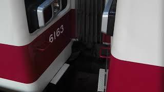 今市駅を発車する 6050系・区間快速(上り)