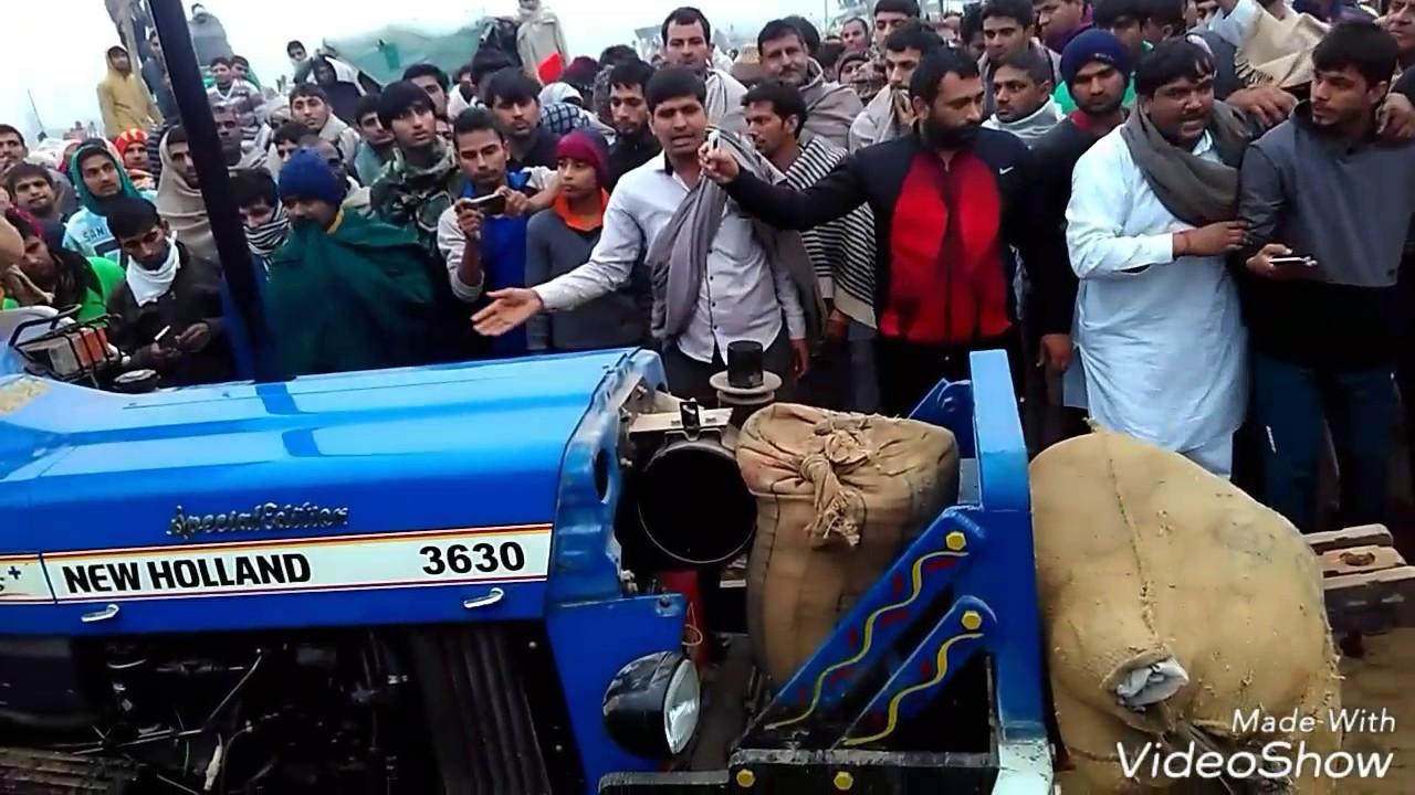 Farmer pulling harrow with tractor on field - CAVF11328 ...   People Pulling Harrows