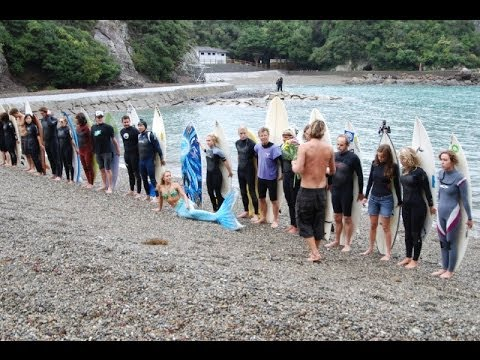 Surfers, Celebrities & Mermaid Paddle Out Defend Dolphins In Taiji Japan