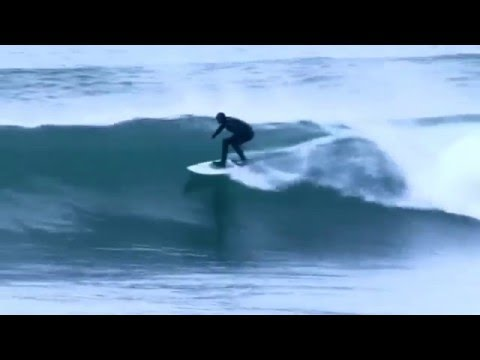 Surfing perfect reef in Kerry, Ireland