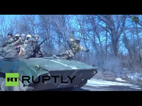 Ukraine: See war-shattered Kiev soldier COLLAPSE off moving Debaltsevo IFV - видео онлайн