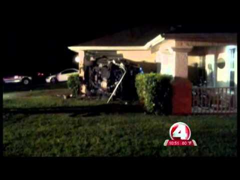 SUV smashes into Lehigh Acres home