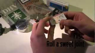 how you roll a charcoal filter joint with 2 tips, a filter stick an...