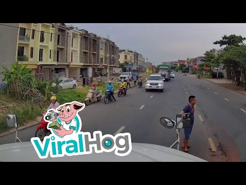 Child Rides into Middle of Busy Road || ViralHog
