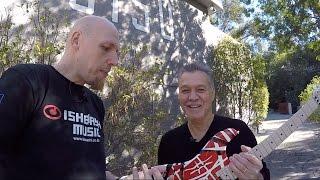 Eddie Van Halen signs guitar for Ishibashi Music Japan
