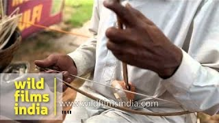 Rajasthani plays Ektara, a traditional stringed instrument of India