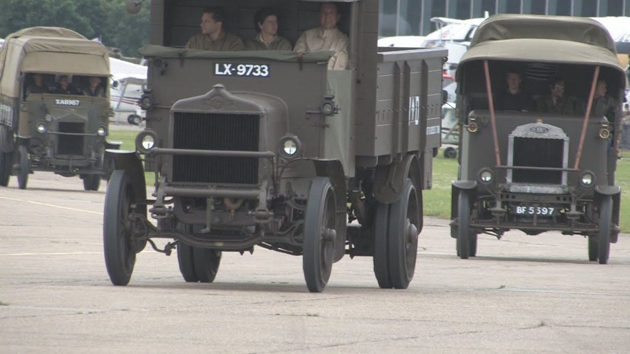 Vintage military road vehicles, at speed, on the Duxford ...