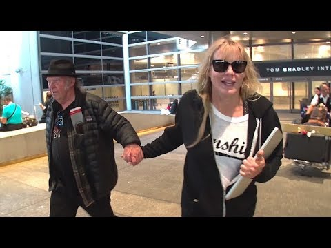 Daryl Hannah Holds Hands With Neil Young At LAX, Is Tight-Lipped About Harvey Weinstein