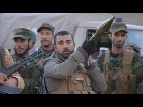 Kurds battle to retake ISIS-held Iraqi town