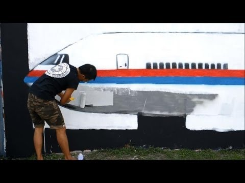 Malaysia graffiti artists paint mural of missing jet