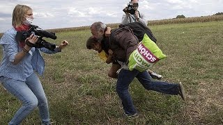 Hungarian camera woman caught on video kicking and tripping migrants