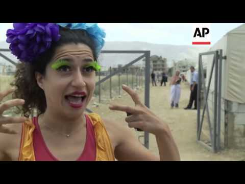 Clowns bring cheer to Syrian refugee children