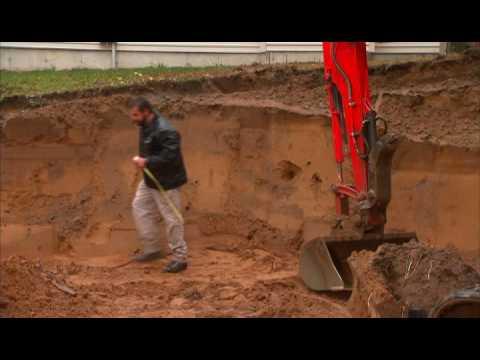 Segmental Retaining Wall Construction - Bench Cut Excavation
