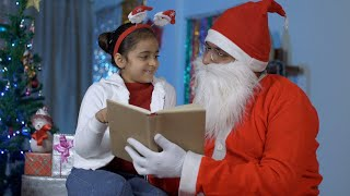 Cute Indian girl spending perfect Christmas holiday with her loving Santa Claus - Christmas Celebration