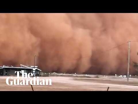 Dust storm's ominous red wall moves from outback to Sydney – video