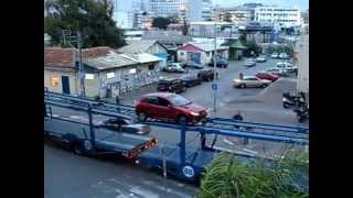 Car transporter stuck with a load. What is the logical thing to do?