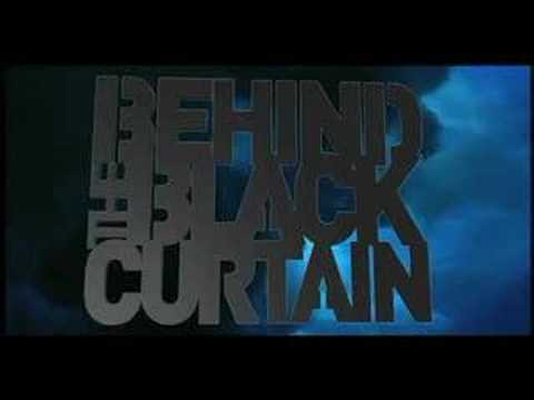 behind the black curtain