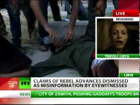 RT Lizzy Phelan  Eyewitnesses dismiss rebel advances on Tripoli as misinformation 21 08 2011