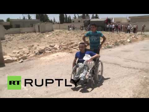 Syria: Russian military distribute two tonnes of humanitarian aid in Homs