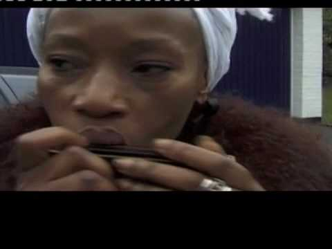 Busi Mhlongo playing harmonica UK 1998