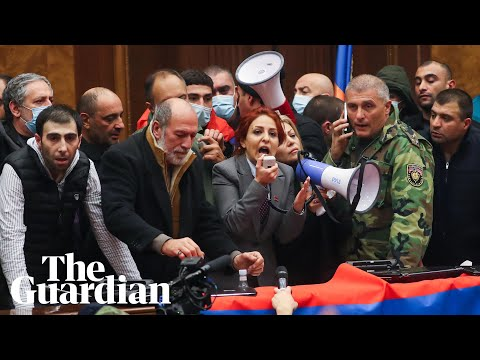 Armenian protesters storm government building after peace deal announced