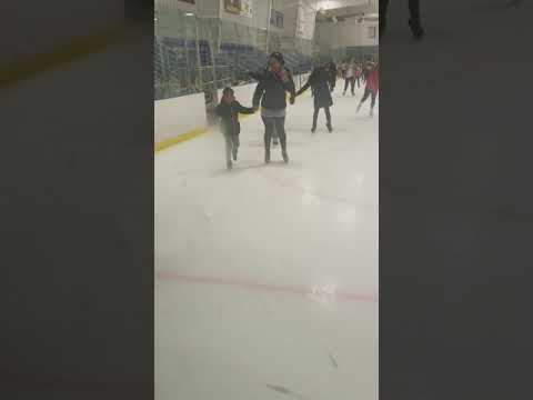 Khiersten and August ice skating for the 1st time Christmas trip 2017