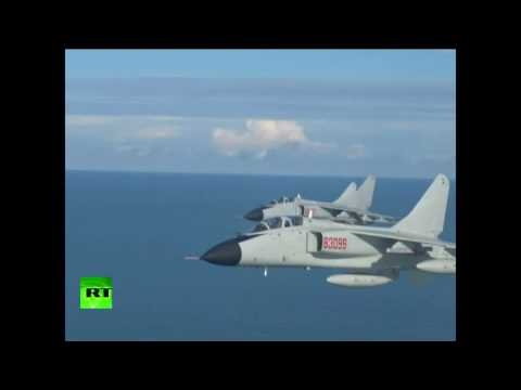 Chinese fighter jets hone combat maneuvers in drills over South China Sea