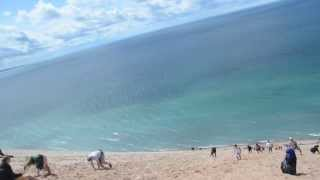 Running down the Sleeping Bear Sand Dunes Scenic Overlook and falling