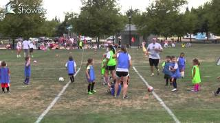 side by side 4v4 u6 soccer games view of coaches