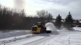 New Holland c238 compact track loader snow blowing.