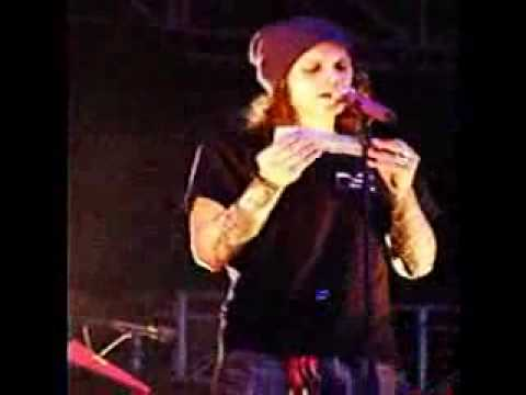 Ville Valo fixing his microphone while singing.avi