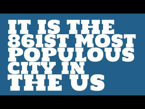 How does the population of Fitchburg, MA compare to Manhattan?