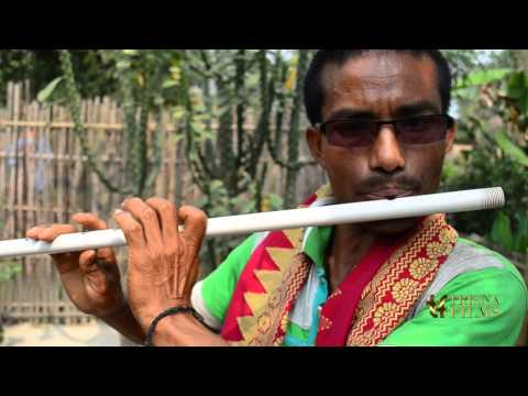 Bodo tribe man playing flute in Assam, India.