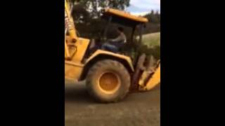 John Deere Backhoe Stunts
