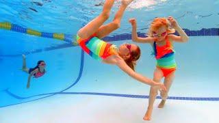 Rainbow Twin Swimming
