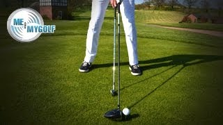 THE GOLF SHAFT POSITION AT ADDRESS
