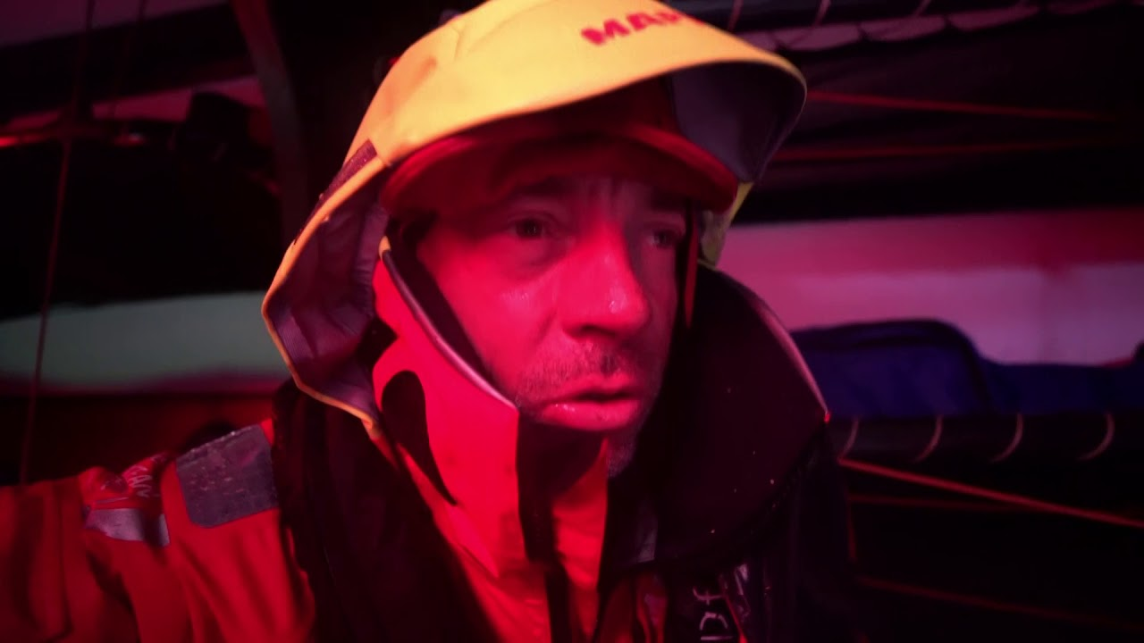 "Rob, in red light below, says as expected wind has built to 35-40 knots. Borderline survival conditions. Willy, below, talks in Spanish. Pablo, below, talks in Spanish. Something involving his gloves. Sophie, below, says when you're holding the mainsheet it's always wet. ""For me that's the coldest time for my hands. It's basically painful."" The other thing about doing the main, she says, is that you're not really moving. ""So after an hour and a half of that you get pretty cold."" Willy talks in Spanish. Rob: In previous Southern Ocean legs got massive torrents of water through the boat, wiping out the helmsman. So we've built a wave breaker, which is on leeward side now so it's useless. Slomo shots on deck. Shot of the ""wave breaker"" (a mesh on the railing in front of the wheel) on the starboard (leeward) wheel."